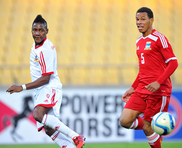 John Calambe of Mauritius challenged by Jones Joubert of Seychelles during the 2015 Cosafa Cup match between Seychelles and Mauritiu at the Royal Bafokeng Stadium in Rustenburg, South Africa on May 21, 2015 ©Samuel Shivambu/BackpagePix