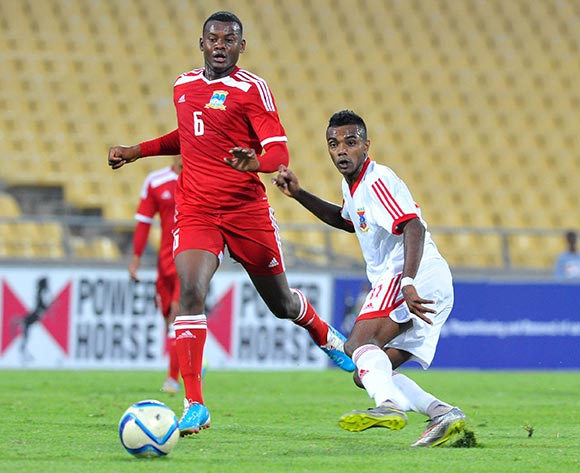 Jean-Pierre Sophie of Mauritius challenged by Benoit Marie of Seychelles during the 2015 Cosafa Cup match between Seychelles and Mauritius at the Royal Bafokeng Stadium in Rustenburg, South Africa on May 21, 2015 ©Samuel Shivambu/BackpagePix
