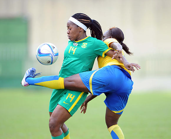 Sanah Mollo of South Africa is challenged by Maye Mabaga Leopoldine of Gabon  during the Olympics Qualifier match between Gabon and South Africa on 23 May 2015 at Augustin Monedan Stadium in Libreville Pic Sydney Mahlangu/BackpagePix