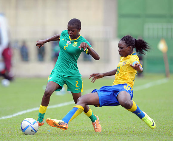 Lebogang Ramalepe of South Africa is challenged by Winnie Mapangou of Gabon  during the Olympics Qualifier match between Gabon and South Africa on 23 May 2015 at Augustin Monedan Stadium in Libreville Pic Sydney Mahlangu/BackpagePix
