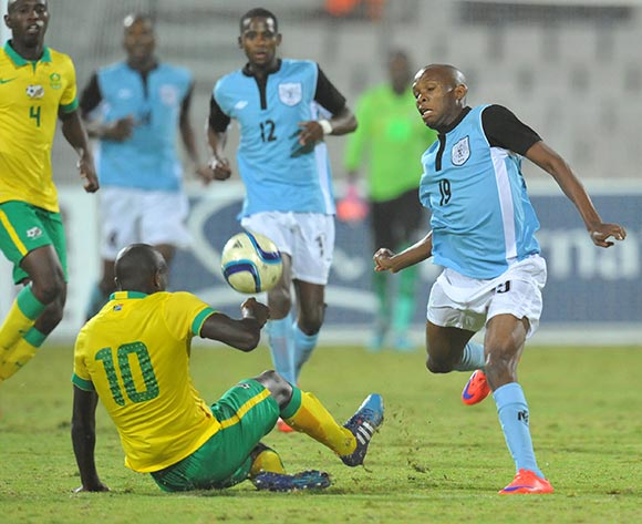 Lemponye Tshireletso of Botswana tackled by Kwanda Mngonyama of South Africa during the 2015 Cosafa Cup Quarter Final match between South Africa v Botswana at Moruleng Stadium, Rustenburg on the 25 May 2015  ©Muzi Ntombela/BackpagePix
