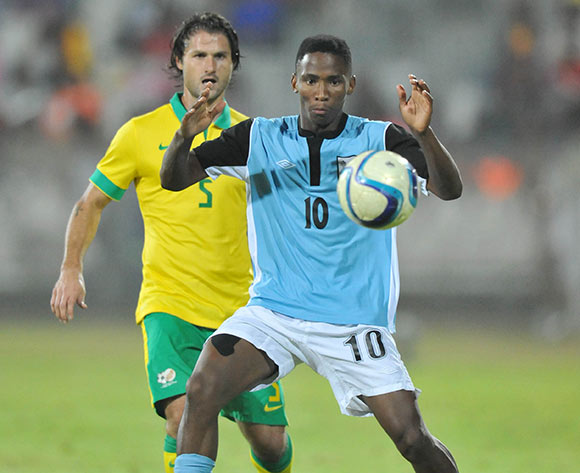 Mpho Kgaswane of Botswana challenged by Marc Van Heerden of South Africa during the 2015 Cosafa Cup Quarter Final match between South Africa v Botswana at Moruleng Stadium, Rustenburg on the 25 May 2015  ©Muzi Ntombela/BackpagePix