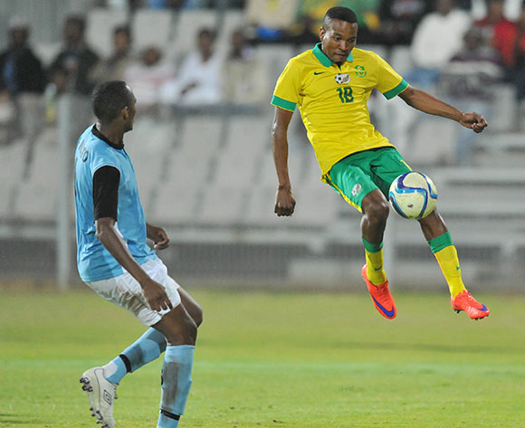 Tlou Segolela of South Africa challenged by Ofentse Nato of Botswana during the 2015 Cosafa Cup Quarter Final match between South Africa v Botswana at Moruleng Stadium, Rustenburg on the 25 May 2015  ©Muzi Ntombela/BackpagePix