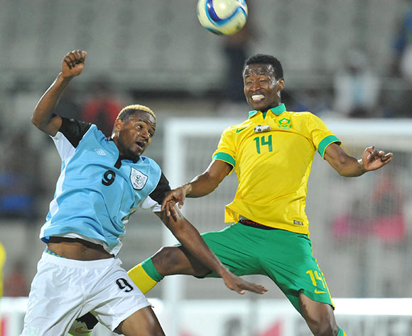 Thamsanqa Sangweni of South Africa battles with Omaatla Kebatho of Botswana during the 2015 Cosafa Cup Quarter Final match between South Africa v Botswana at Moruleng Stadium, Rustenburg on the 25 May 2015  ©Muzi Ntombela/BackpagePix