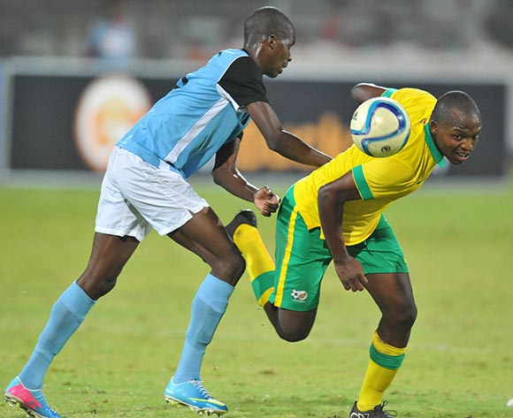 Gift Moputa of South Africa battles with Oteng Legwaila of Botswana during the 2015 Cosafa Cup Quarter Final match between South Africa v Botswana at Moruleng Stadium, Rustenburg on the 25 May 2015  ©Muzi Ntombela/BackpagePix
