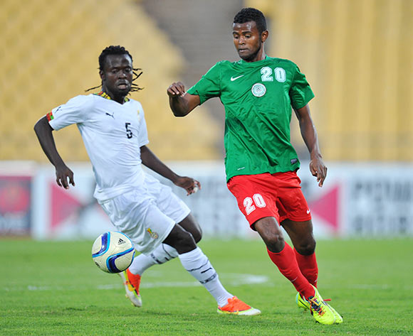 Rihno Michel of Madagascar challenged by Malik Akowuah of Ghana during the 2015 Cosafa Cup Quarter Final match between Ghana and Madagascar at Royal Bafokeng Stadium, Rustenburg on the 25 May 2015  ©Muzi Ntombela/BackpagePix
