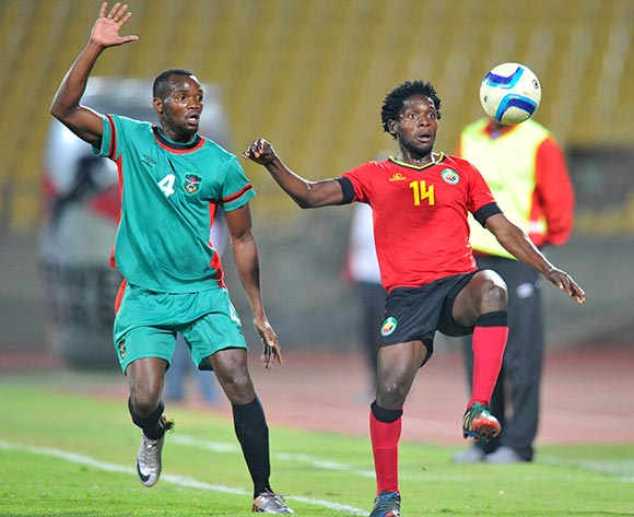 Diogo Alberto of Mozambique challenged by John Lanjesi of Malawi during the 2015 Cosafa Cup Quarter Final match between Mozambique and Malawi at Royal Bafokeng Stadium, Rustenburg on the 25 May 2015  ©Muzi Ntombela/BackpagePix