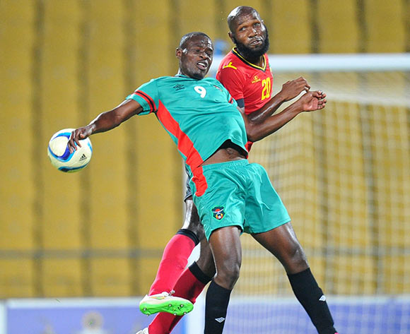 Estevo Massango of Mozambique battles with Muhammad Sulumba of Malawi during the 2015 Cosafa Cup Quarter Final match between Mozambique and Malawi at Royal Bafokeng Stadium, Rustenburg on the 25 May 2015  ©Muzi Ntombela/BackpagePix