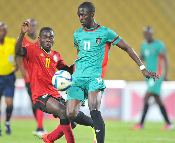 Robin Ngalande of Malawi challenged by Luis Miquissone of Mozambique during the 2015 Cosafa Cup Quarter Final match between Mozambique and Malawi at Royal Bafokeng Stadium, Rustenburg on the 25 May 2015  ©Muzi Ntombela/BackpagePix