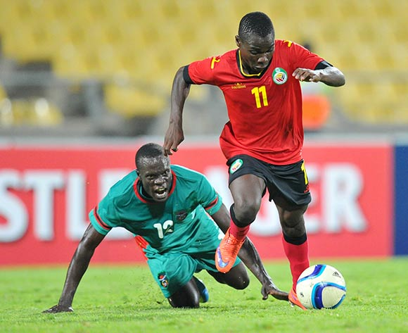 Luis Miquissone of Mozambique challenged by Chimongo Kayira of Malawi during the 2015 Cosafa Cup Quarter Final match between Mozambique and Malawi at Royal Bafokeng Stadium, Rustenburg on the 25 May 2015  ©Muzi Ntombela/BackpagePix