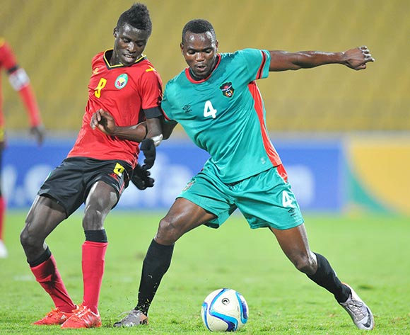John Lanjesi of Malawi challenged by Witness Quembo of Mozambique during the 2015 Cosafa Cup Quarter Final match between Mozambique and Malawi at Royal Bafokeng Stadium, Rustenburg on the 25 May 2015  ©Muzi Ntombela/BackpagePix