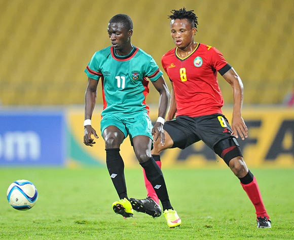 Robin Ngalande of Malawi challenged by Gabriel Dove of Mozambique during the 2015 Cosafa Cup Quarter Final match between Mozambique and Malawi at Royal Bafokeng Stadium, Rustenburg on the 25 May 2015  ©Muzi Ntombela/BackpagePix