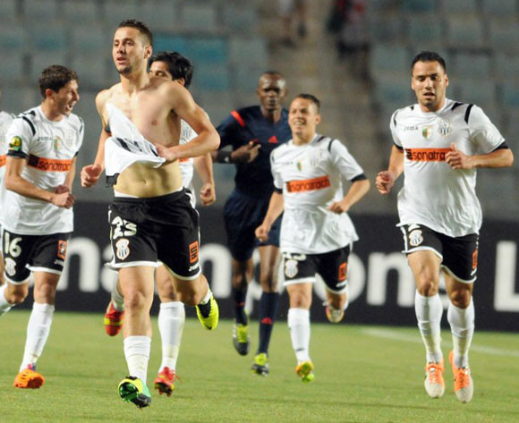 Defending champs Sétif scrape through on penalties