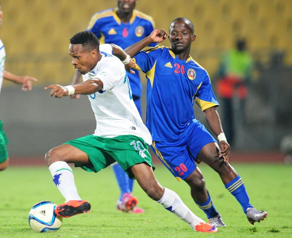 Mabuti Potloane of Lesotho challenged by Xolani Sibandze of Swaziland during the 2015 Cosafa Cup match between Lesotho and Swaziland at the Royal Bafokeng Stadium, Rustenburg on the 20 May 2015
