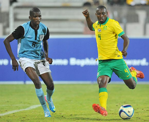 Siyabonga Nhlapo of South Africa challenged by Oteng Legwaila of Botswana during the 2015 Cosafa Cup Quarter Final match between South Africa v Botswana at Moruleng Stadium, Rustenburg on the 25 May 2015  ©Muzi Ntombela/BackpagePix
