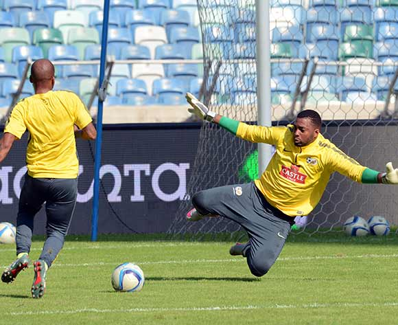 Itumeleng Khune saves a ball from Oupa Manyisa  during  South Africa  training session on 12 June 2015 at Moses Mabhida Stadium Pic Sydney Mahlangu/BackpagePix
