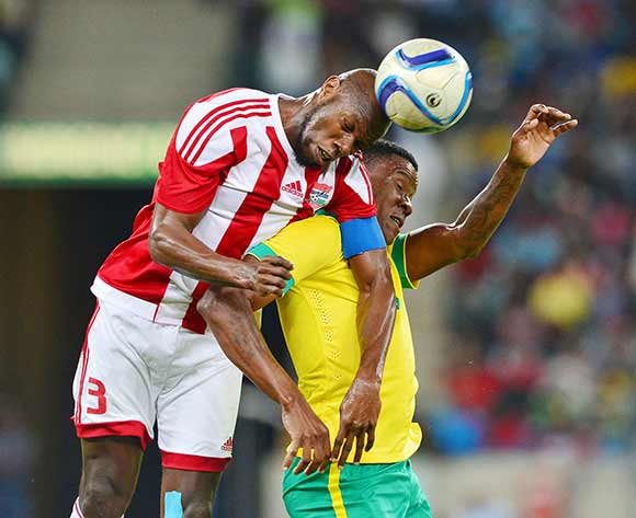 Ousman Koli of Gambia (l) heads ball clear of Thamsanqa Gabuza of South Africa during the 2017 Afcon Qualifier football match between South Africa and Gambia at the Moses Mabhida Stadium in Durban on 13 June 2015 ©Gavin Barker/BackpagePix
