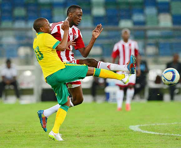 Thulani Serero of South Africa (l) and Ebrima Sohna of Gambia  challenge for ball during the 2017 Afcon Qualifier football match between South Africa and Gambia at the Moses Mabhida Stadium in Durban on 13 June 2015 ©Gavin Barker/BackpagePix