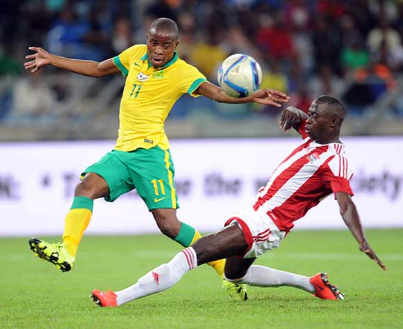 Thabo Matlaba of South Africa is tackled by Modou Barrow of Gambia during 2017 Afcon Qualifier match between South Africa and Gambia  on 13 June 2015 at Moses Mabhida Stadium Pic Sydney Mahlangu/BackpagePix