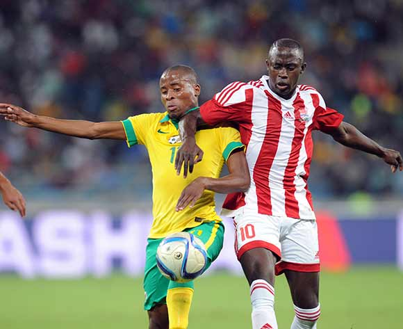 Thabo Matlaba of South Africa is challenged  by Modou Barrow of Gambia during 2017 Afcon Qualifier match between South Africa and Gambia  on 13 June 2015 at Moses Mabhida Stadium Pic Sydney Mahlangu/BackpagePix