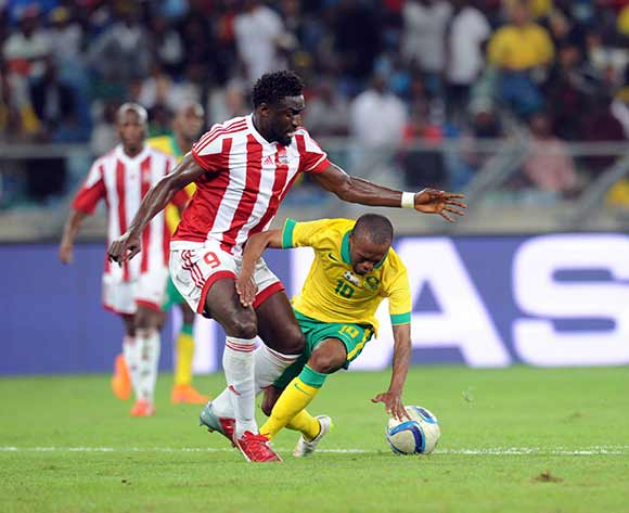 Thulani Serero of South Africa is tackled by Pa Modou Jagne of Gambia   during 2017 Afcon Qualifier match between South Africa and Gambia  on 13 June 2015 at Moses Mabhida Stadium Pic Sydney Mahlangu/BackpagePix