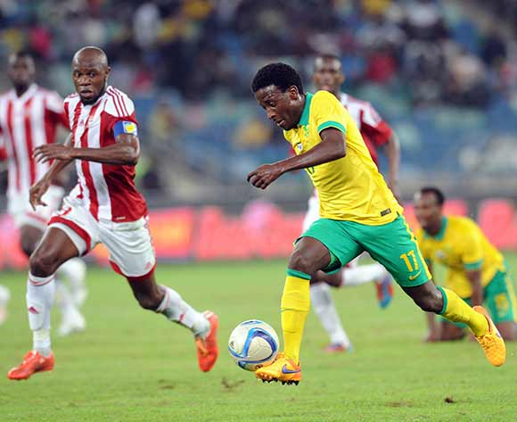 Abdou Jammeh of Gambia challenges  Siphelele Ntshangase of South Africa during 2017 Afcon Qualifier match between South Africa and Gambia  on 13 June 2015 at Moses Mabhida Stadium Pic Sydney Mahlangu/BackpagePix
