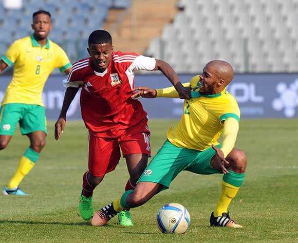 Wandisile Letlabika of South Africa is held back by  Nick Jeffrey Obrian Curpanen of Mauritius during the CHAN Qualifier match between South Africa and Mauritius  on 20 June 2015 at Dobsonville Stadium Pic Sydney Mahlangu/BackpagePix