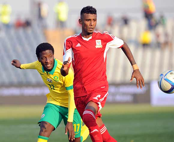 Siphelele Ntshangase of South Africa challenges for the ball with Emmanuel Vincent Jean of Mauritius  during the CHAN Qualifier match between South Africa and Mauritius  on 20 June 2015 at Dobsonville Stadium Pic Sydney Mahlangu/BackpagePix