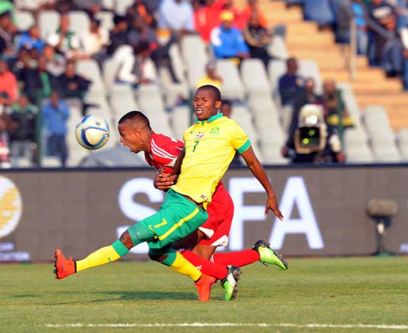 Mandla Masango of South Africa is tackled by Jimmy Percy Hendrix Buckland of Mauritius