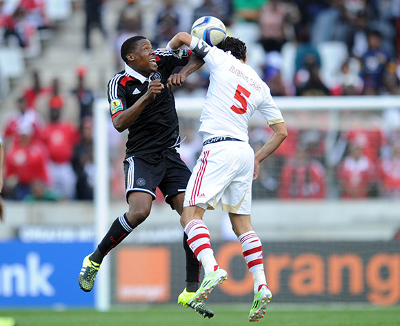 Thamsanqa Gabuza of Orlando Pirates  challenges for the ball with Ibrahim Sahah of Zamalek during the 2015 CAF Confederation Cupmatch between Orlando Pirates and Zamalek on 11 July 2015 at Mbombela StadiumPic Sydney Mahlangu/BackpagePix