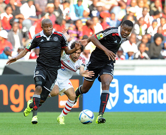 Alhy Hefny of Zamalek is challenged by Thabo Matlaba of Orlando Pirates (l) and Thamsanqa Gabuza of Orlando Pirates (r) during the 2015 CAF Confederation Cupmatch between Orlando Pirates and Zamalek on 11 July 2015 at Mbombela StadiumPic Sydney Mahlangu/BackpagePix