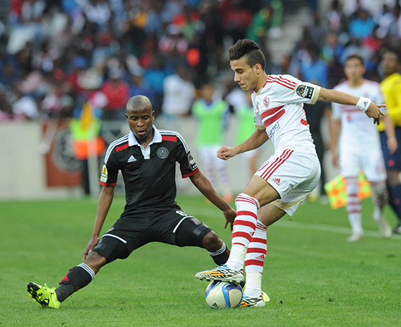 Mustafa Mohamed of Zamalek is challenged by Thabo Matlaba of Orlando Pirates during the 2015 CAF Confederation Cup match between Orlando Pirates and Zamalek on 11 July 2015 at Mbombela StadiumPic Sydney Mahlangu/BackpagePix