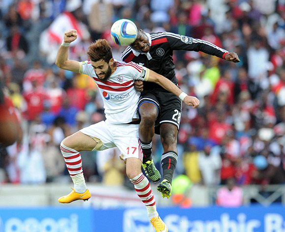 Basem Morsy of Zamalek  is challenged by Rooi Mahamutsa of Orlando Pirates  during the 2015 CAF Confederation Cup match between Orlando Pirates and Zamalek on 11 July 2015 at Mbombela StadiumPic Sydney Mahlangu/BackpagePix