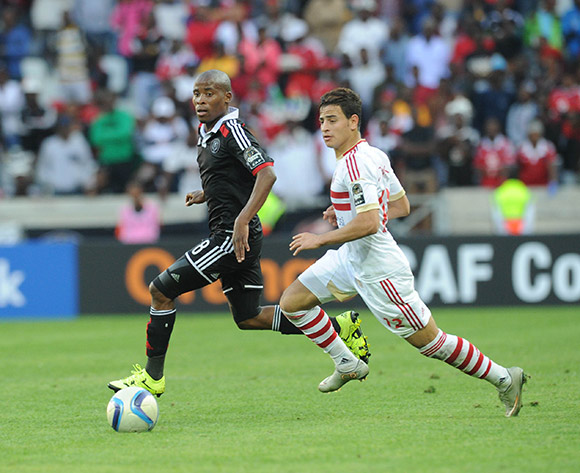 Thabo Matlaba of Orlando Pirates is challenged by Ahmed Tawfik of Zamalek  during the 2015 CAF Confederation Cup match between Orlando Pirates and Zamalek on 11 July 2015 at Mbombela StadiumPic Sydney Mahlangu/BackpagePix