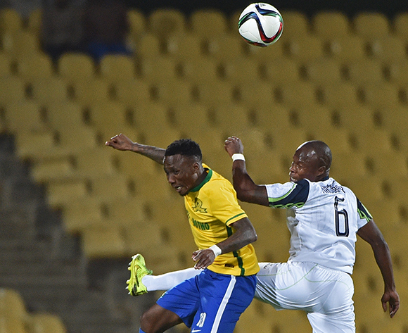 Teko Modise of Mamelodi Sundowns wins control of the ball in the air from Bongani Nyathi of Platinum Stars during the 2015/16 Absa Premiership football match between Platinum Stars and Mamelodi Sundowns at the Royal Bafokeng Stadium in Rustenburg, South Africa on 08 August , 2015 