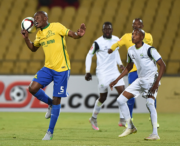Asavela Mbekile of Mamelodi Sundowns wins control of the ball from Mahlatse Makudubela of Platinum Stars during the 2015/16 Absa Premiership football match between Platinum Stars and Mamelodi Sundowns at the Royal Bafokeng Stadium in Rustenburg, South Africa on 08 August , 2015 