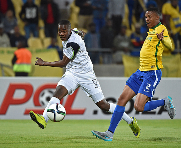 Bonginkosi Ntuli of Platinum Stars takes a shot at goal with Thabo Nthethe of Mamelodi Sundowns the defender during the 2015/16 Absa Premiership football match between Platinum Stars and Mamelodi Sundowns at the Royal Bafokeng Stadium in Rustenburg, South Africa on 08 August , 2015 