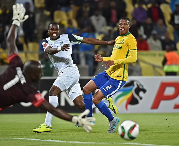 Bonginkosi Ntuli of Platinum Stars takes a shot at goal with Thabo Nthethe of Mamelodi Sundowns the defender during the 2015/16 Absa Premiership football match between Platinum Stars and Mamelodi Sundowns at the Royal Bafokeng Stadium in Rustenburg, South Africa on 08 August , 2015   ©Anton de Villiers/BackpagePix
