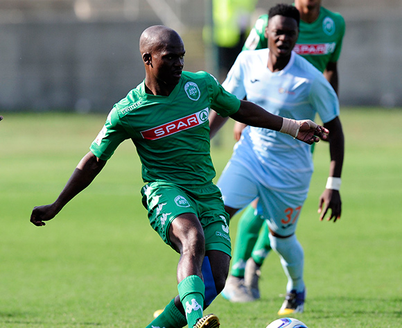 Goodman Dlamini of AmaZulu pushes the ball forward as Julius Linkontsane of Witbank Spurs closes in during the National Football Division match between AmaZulu and Witbank Spurs at the King Zwelithini Stadium in Umlazi, South Africa on August 22, 2015 ©Gerhard Duraan/BackpagePix