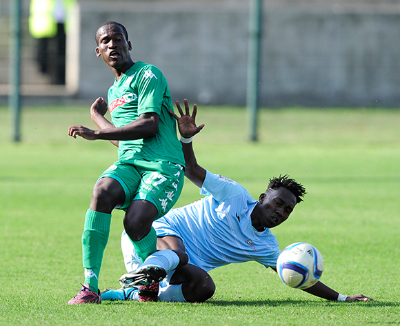 Mbongweni Gumede of AmaZulu gets the ball away despite the efforts of Julius Linkontsane of Witbank Spurs  during the National Football Division match between AmaZulu and Witbank Spurs at the King Zwelithini Stadium in Umlazi, South Africa on August 22, 2015 ©Gerhard Duraan/BackpagePix