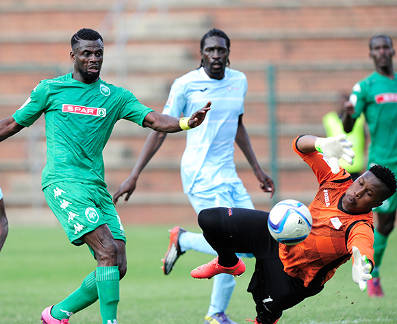 Sadate Ouro-Akoriko of AmaZulu has a go at the goals, Zama Dlamini (GK) of Witbank Spurs  is desperate to stop the ball during the National Football Division match between AmaZulu and Witbank Spurs at the King Zwelithini Stadium in Umlazi, South Africa on August 22, 2015 ©Gerhard Duraan/BackpagePix