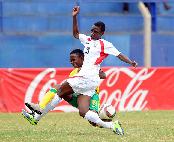 Rhoda Mulaudzi of South Africa is challenged by  Irene Awuor Ogutu of Kenya  during the Olympic Qualifier 2nd Leg match between Kenya and South Africa on 02 August 2015 at Machakos Stadium  Pic Sydney Mahlangu/ BackpagePix