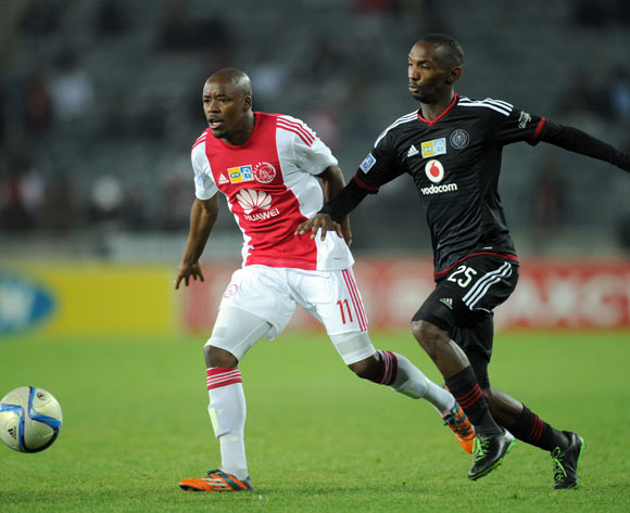 Thabo Rakhale of Orlando Pirates challenges  Bantu Mzwakali of Ajax Cape Town during the MTN8 Quarter Final match between Orlando Pirates and Ajax Cape Town on 04 August 2015 at Orlando Stadium
