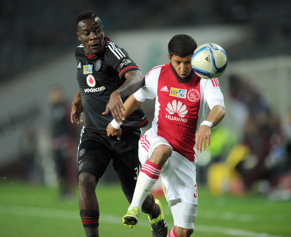 Ntsikelelo Nyauza of Orlando Pirates is challenged by Riyaad Norodien of Ajax Cape Town  during the MTN8 Quarter Final match between Orlando Pirates and Ajax Cape Town on 04 August 2015 at Orlando Stadium