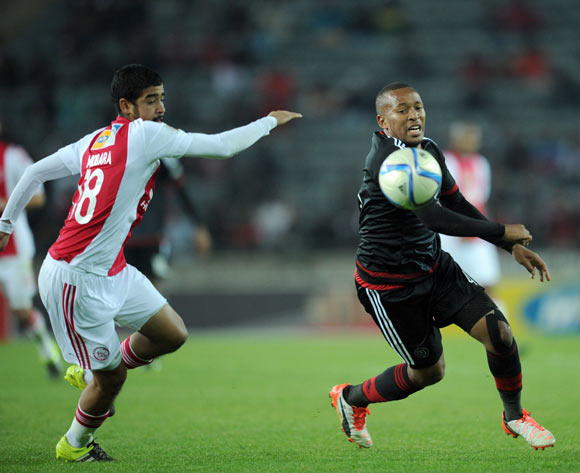 Lehlohonolo Majoro of Orlando Pirates is challenged by Abbubaker Mobara of Ajax Cape Town  during the MTN8 Quarter Final match between Orlando Pirates and Ajax Cape Town on 04 August 2015 at Orlando Stadium