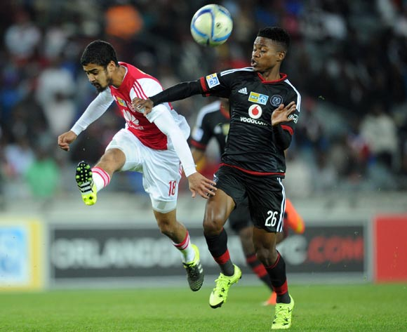 Menzi Masuku of Orlando Pirates is challenged by Abbubaker Mobara of Ajax Cape Town  during the MTN8 Quarter Final match between Orlando Pirates and Ajax Cape Town on 04 August 2015 at Orlando Stadium