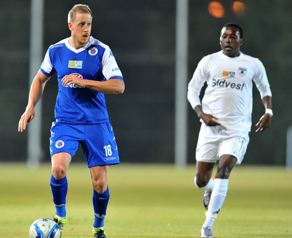 Michael Morton of Supersport United challenged by Elias Pelembe of Bidvest Wits during the 2015 MTN8 match between Bidvest Wits and Supersport United at the Bidvest Stadium in Johannesburg, South Africa on August 04, 2015