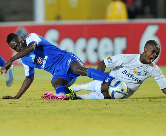 Phumlani Ntshangase of Bidvest Wits challenged by Dove Wome of Supersport United during the 2015 MTN8 match between Bidvest Wits and Supersport United at the Bidvest Stadium in Johannesburg, South Africa on August 04, 2015