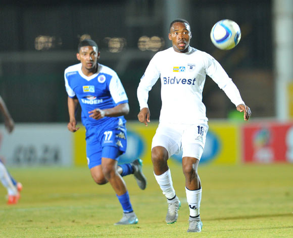 Sibusiso Vilakazi of Bidvest Wits challenged by Morne Nel of Supersport United during the 2015 MTN8 match between Bidvest Wits and Supersport United at the Bidvest Stadium in Johannesburg, South Africa on August 04, 2015