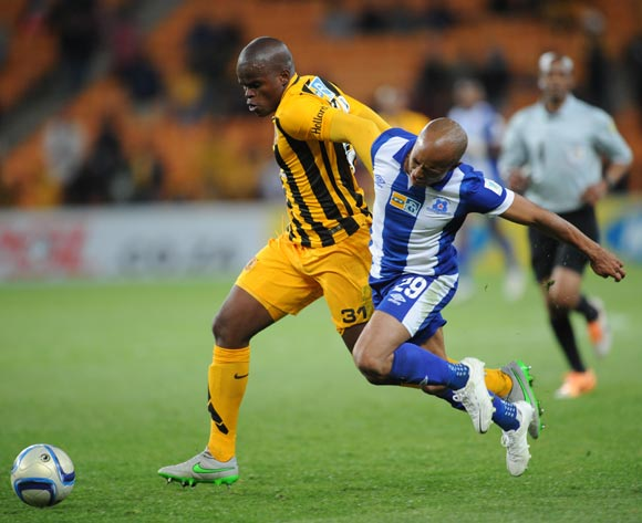Willard Katsande of Kaizer Chiefs is challenged  by Kurt Lentjies of Maritzburg United during the MTN8 Quarter Final between Kaizer Chiefs and Maritzburg United on 05 August 2015 at FNB Stadium